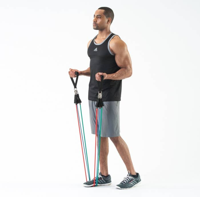 The set of resistance bands held by a man