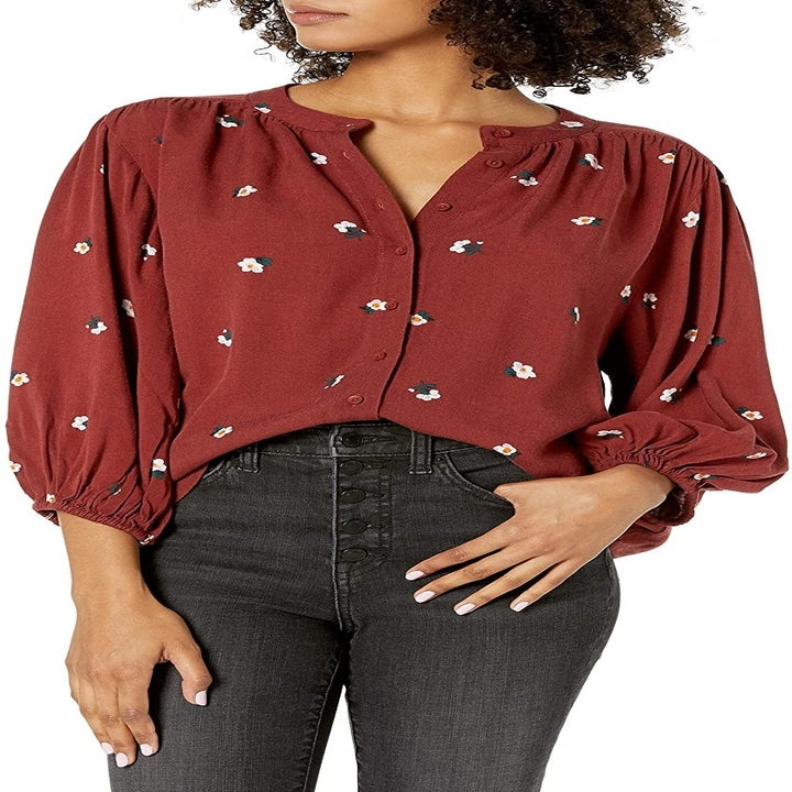 Front view of a model wearing the russet floral blouse