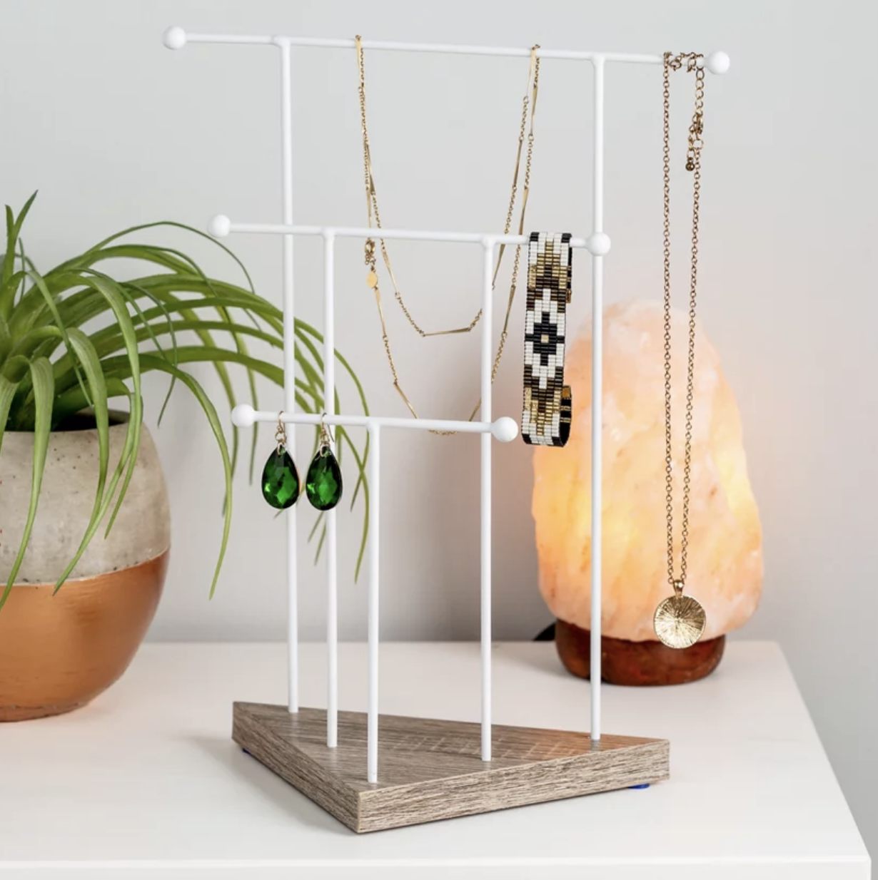 Three-tier jewelry stand with necklaces, earrings and bracelets