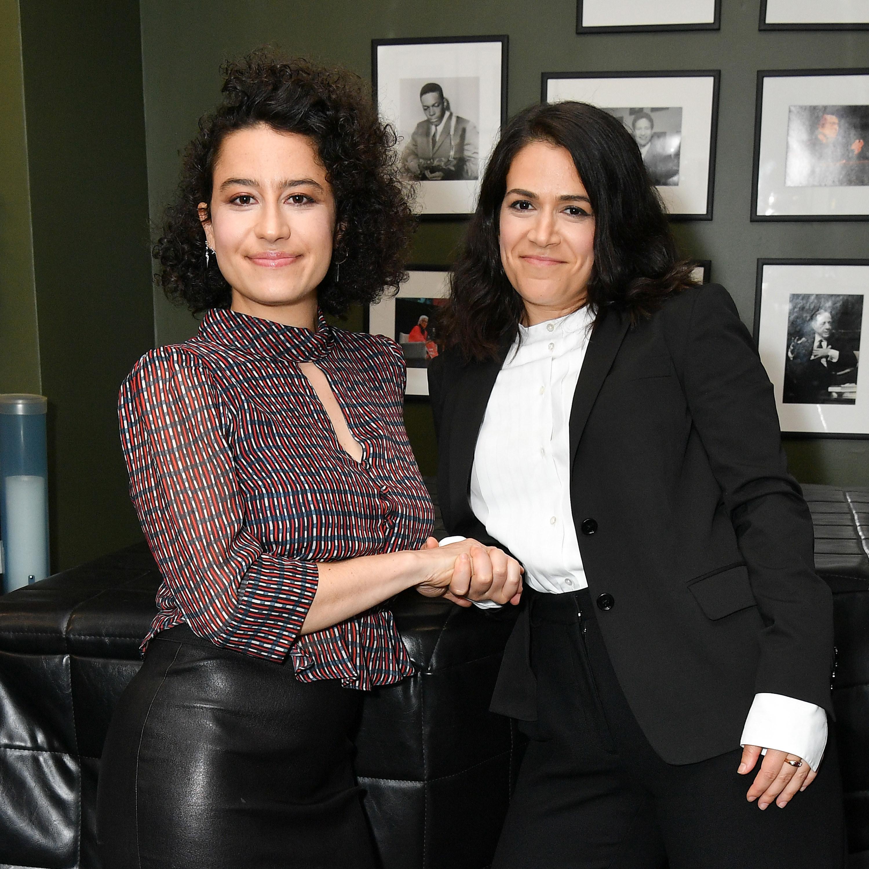 Photo of Ilana Glazer and Abbi Jacobson shaking hands