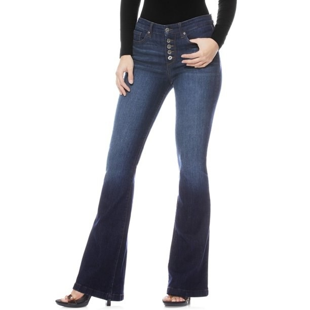 Model in high waist flare jeans