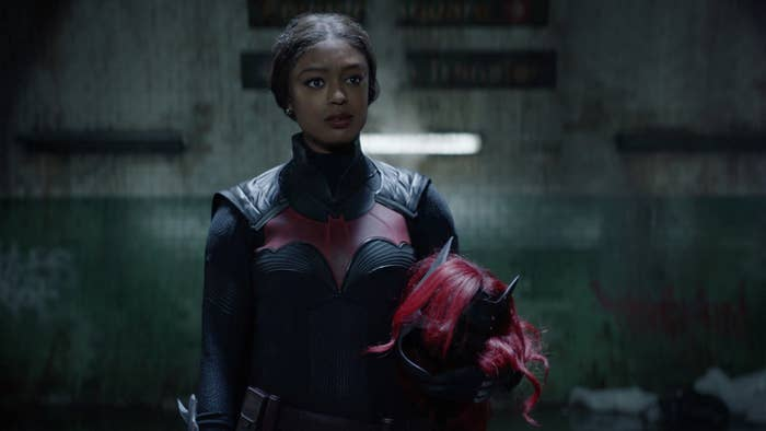 Javicia Leslie as Batwoman holding her cowl