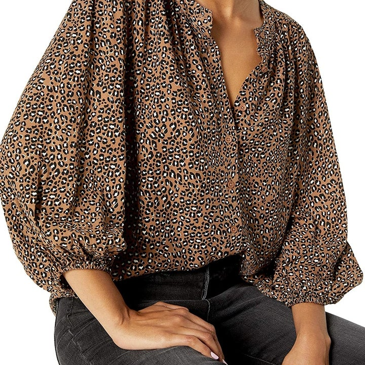 Front view of a model wearing the animal print blouse