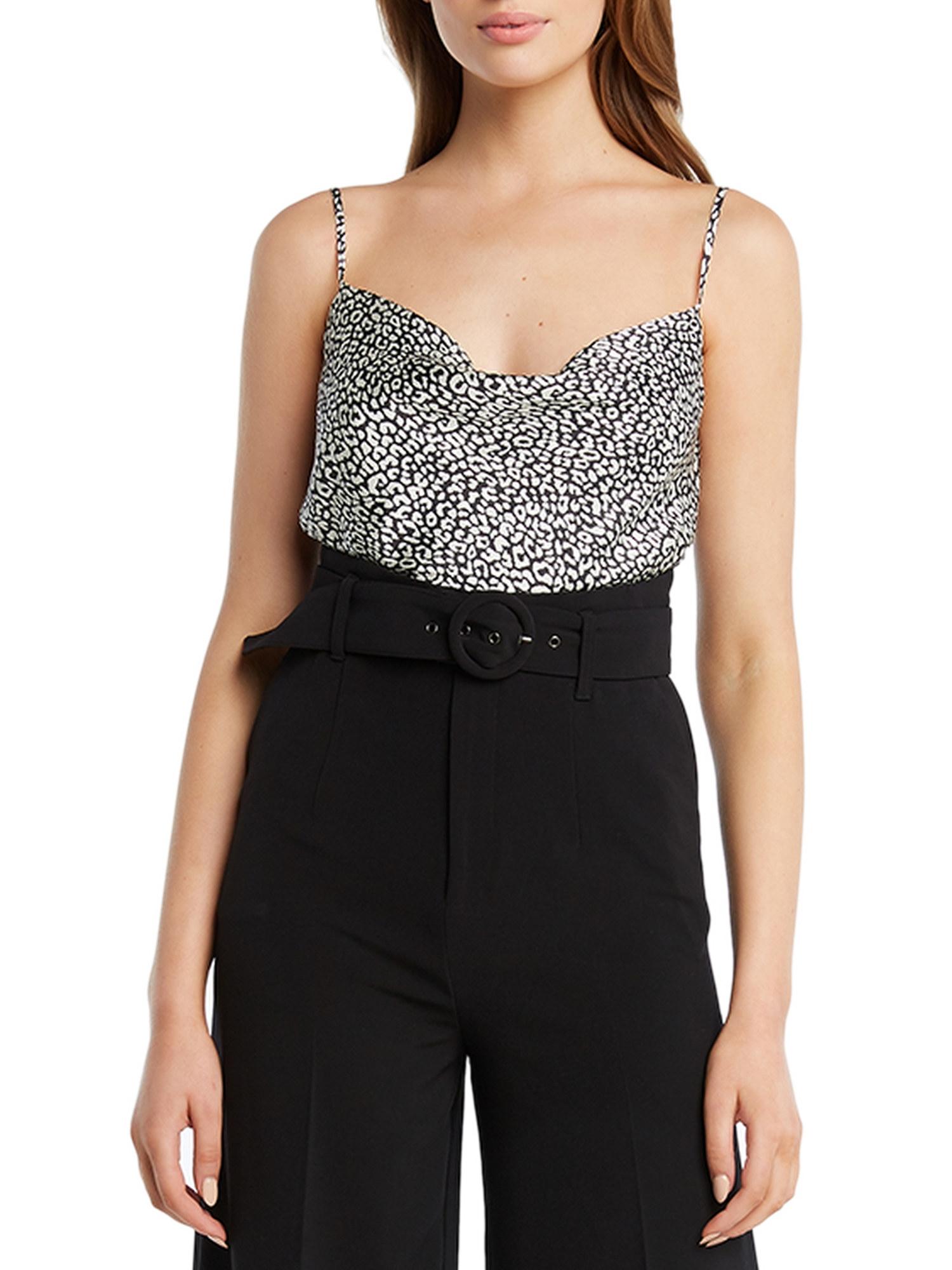 Model in cheetah print cami and black pants