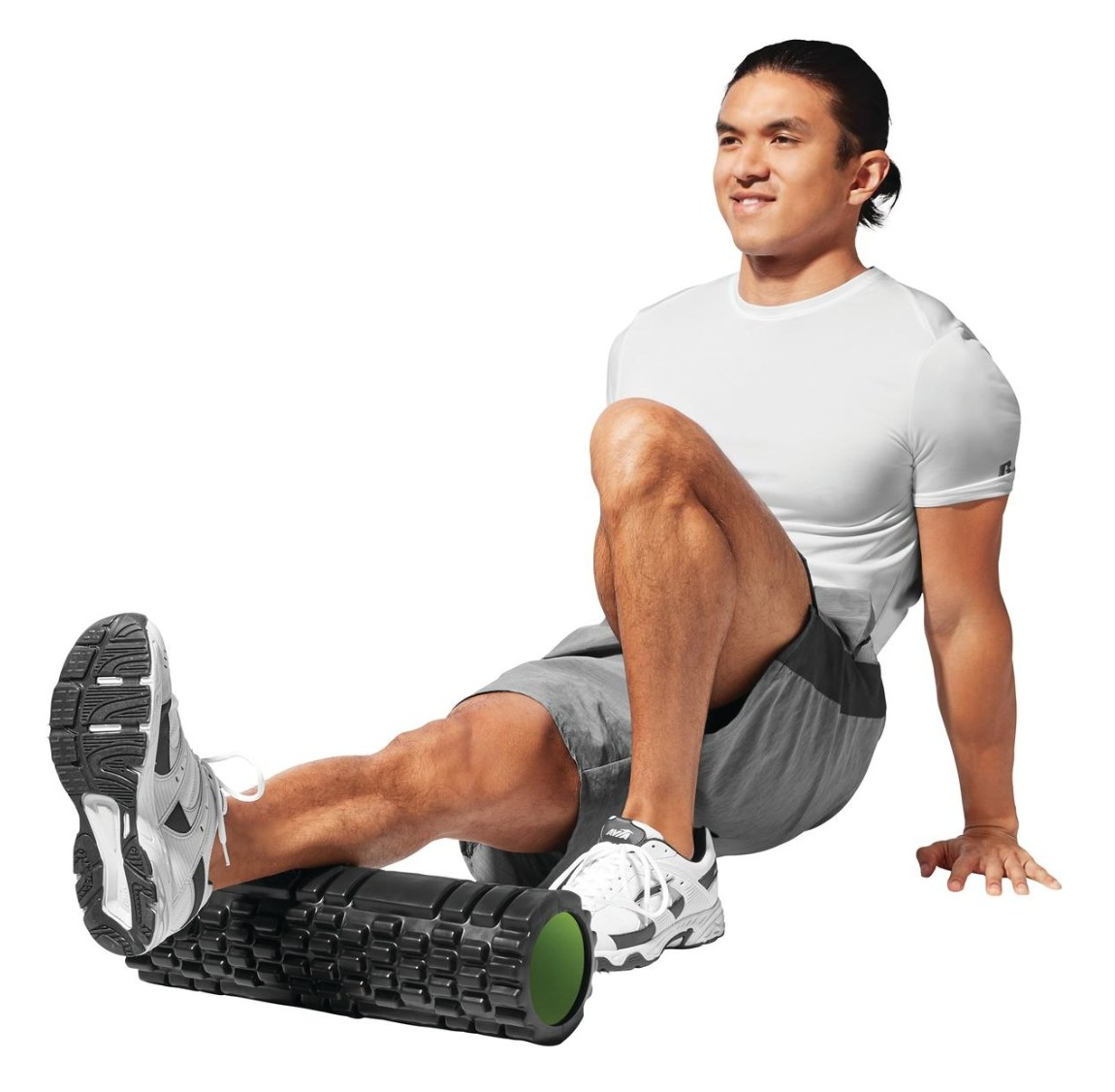 The massage roller in black and green