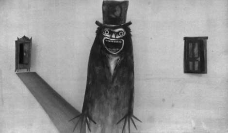 Screen shot of a charcoal sketch of the Babadook