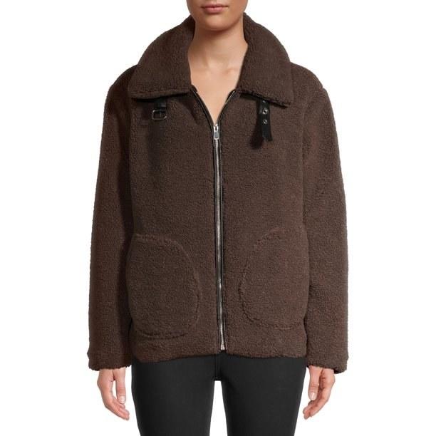 Model in faux sherpa zip jacket
