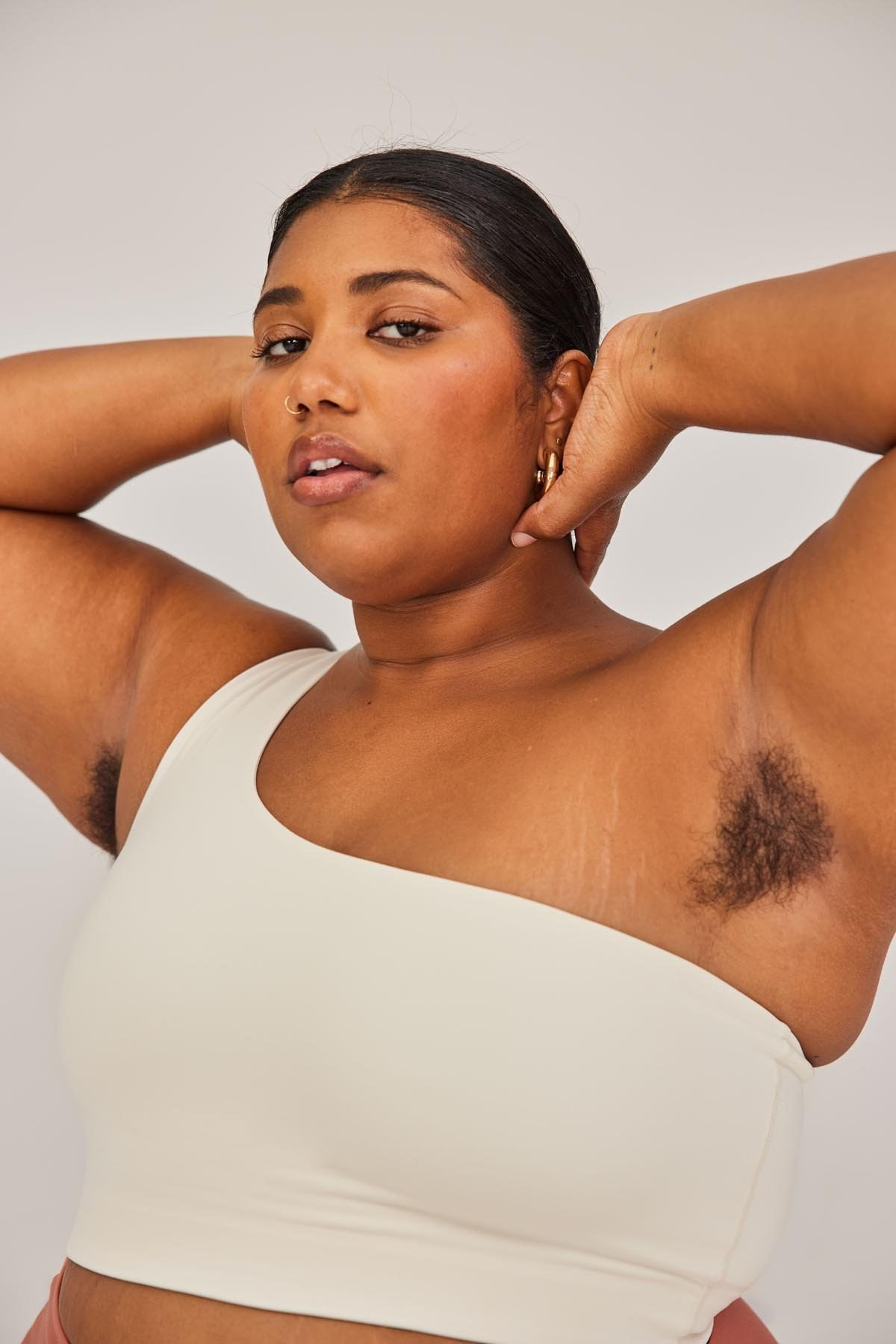 model wearing the one-shoulder bra in white