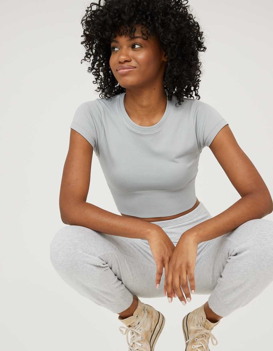 model wearing the tight cropped tee in light blue