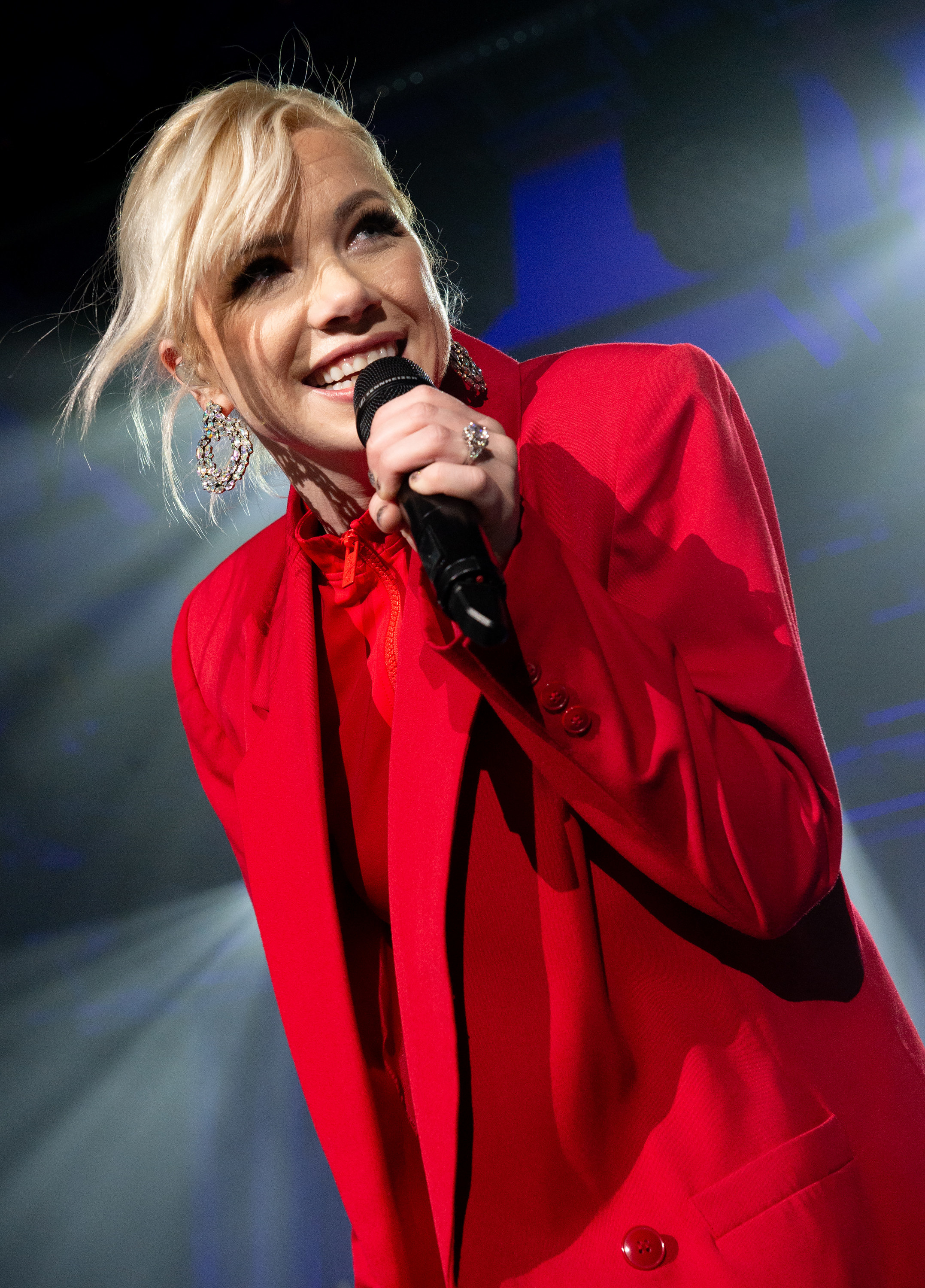 Carly Rae on stage signing wearing all red