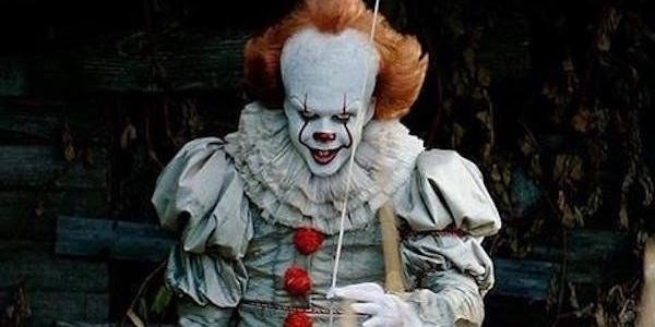 Pennywise holding a balloon looking evil