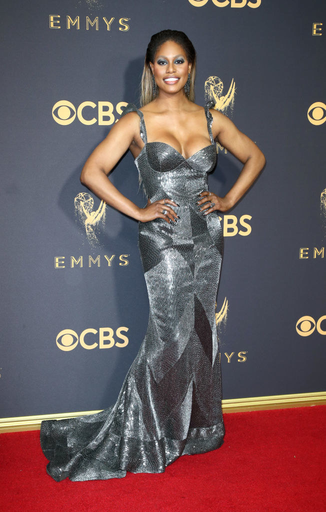 Laverne in a metallic glitter mermaid dress with a small train and a corset like bra top with tank top straps and patchwork sewn fabric