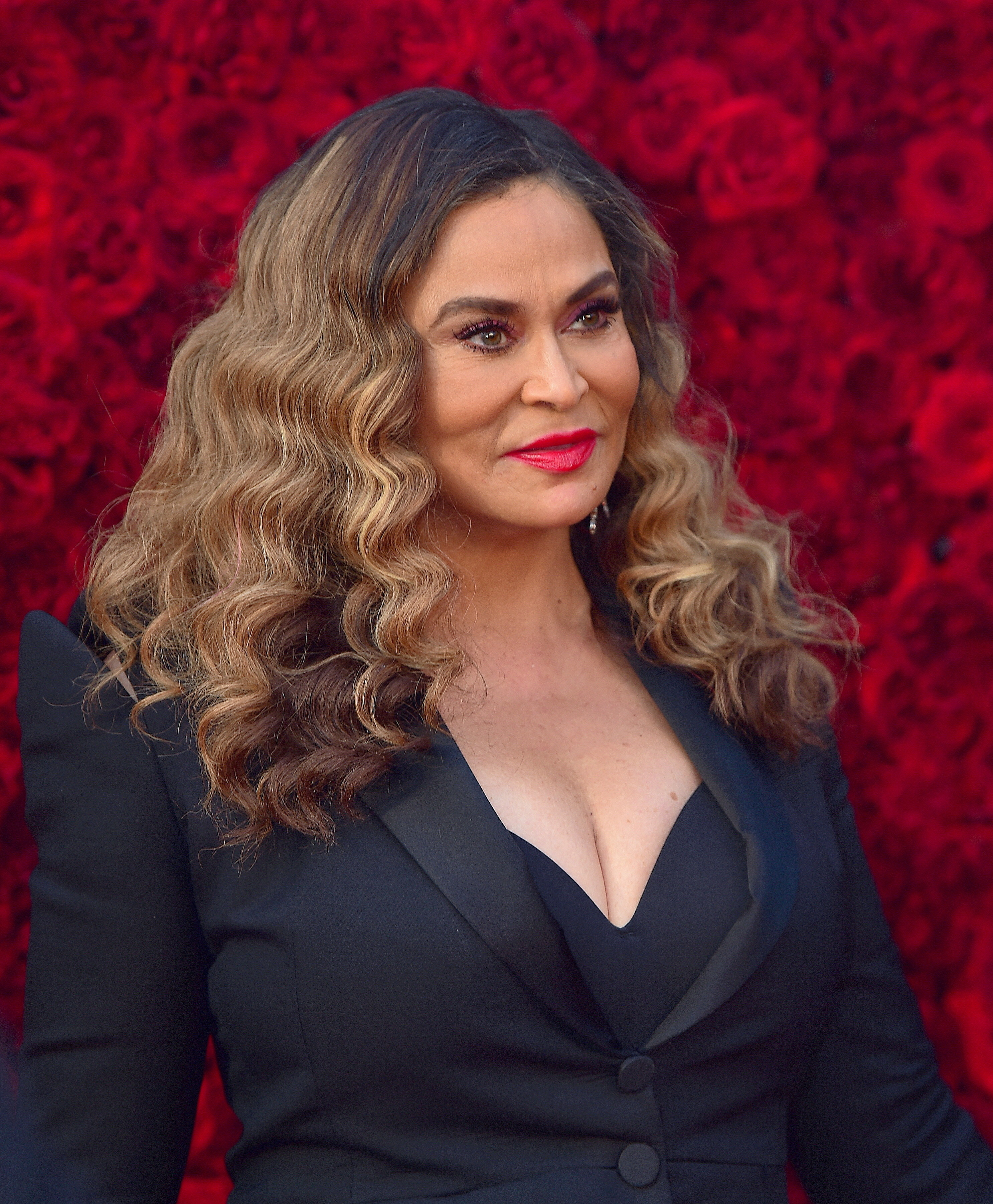 Tina Knowles at event wearing a black suit