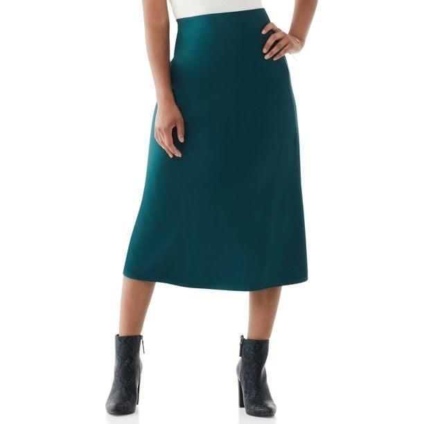 Model in midi slip skirt