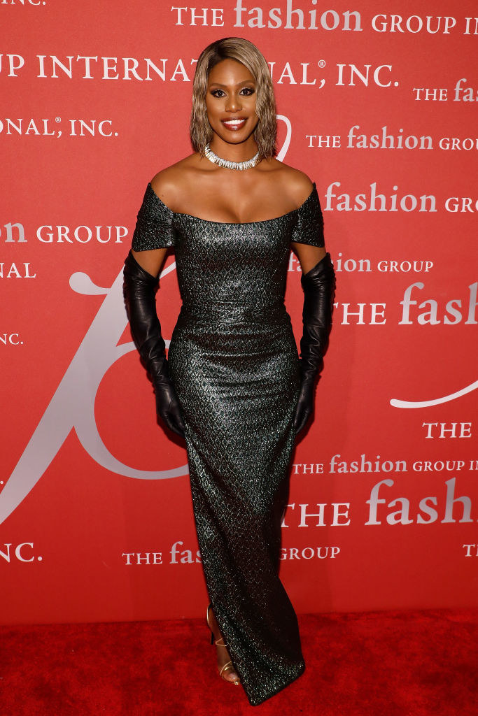 Laverne in a glitter long tight off the shoulder short sleeve gown with a subtle scale mermaid-like texture and long leather gloves