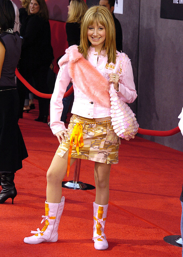 Ashley on a red carpet wearing lots of 2000s trends all at once