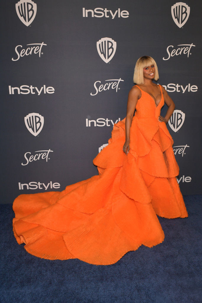 Laverne in a layered tank top deep v neck dress with a long layered skirt with a long train