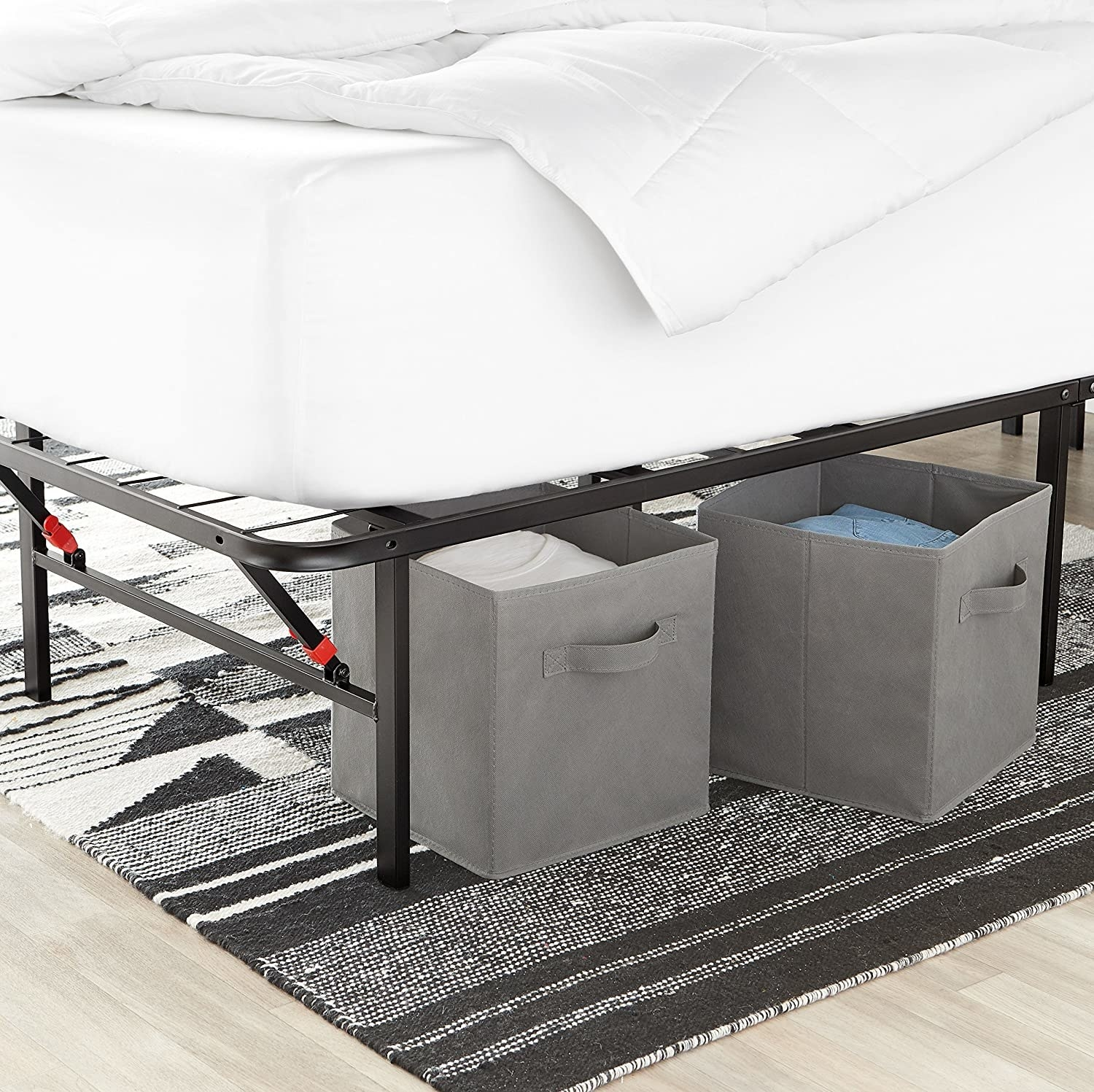 Two gray storage cubes placed underneath bed