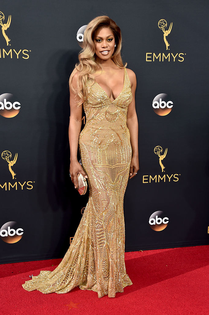 Laverne in a strapless v neck mermaid metallic dress with geometric embroidery all over and a small train