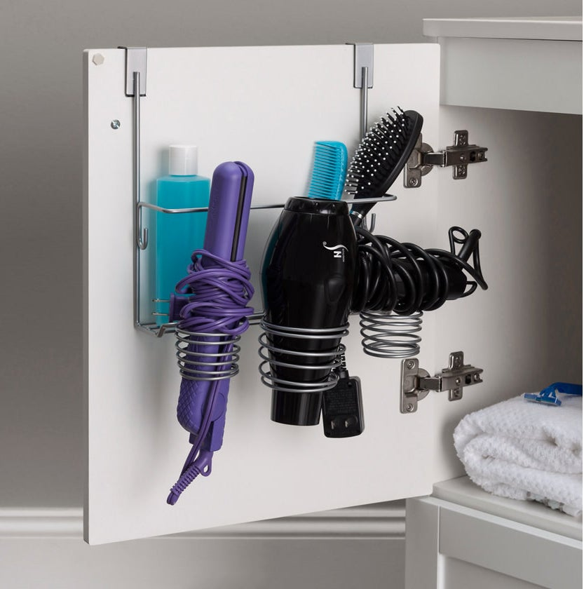 Storage shelf hanging over top of cabinet with hair dryer and straightener placed inside