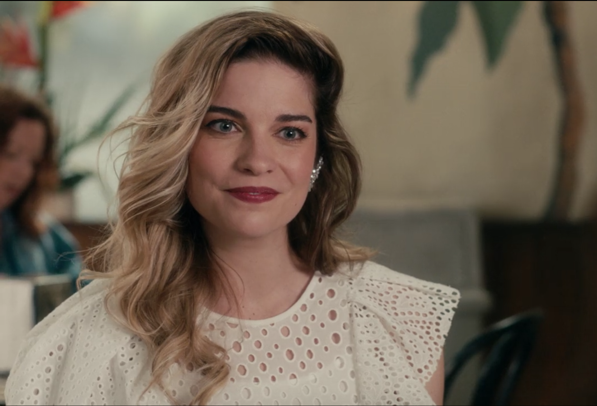 Screenshot of Alexis smiling