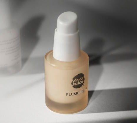 The glass bottle which has a white pump