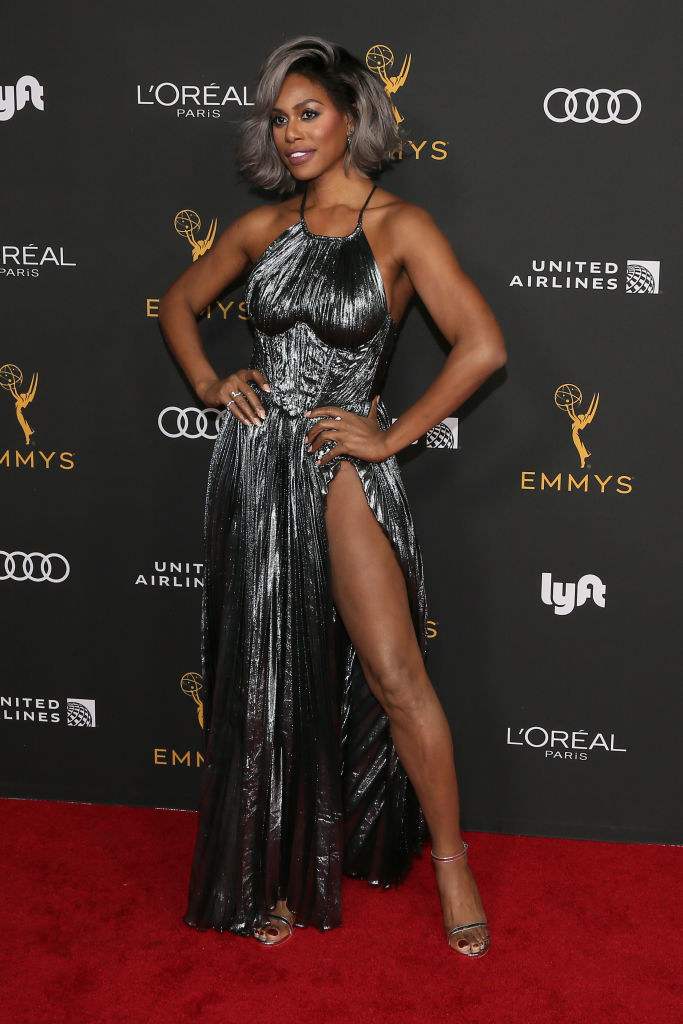 Laverne  in a halter metallic ruched dress with pleats all over, a high slit, and a corset waist with a looser top