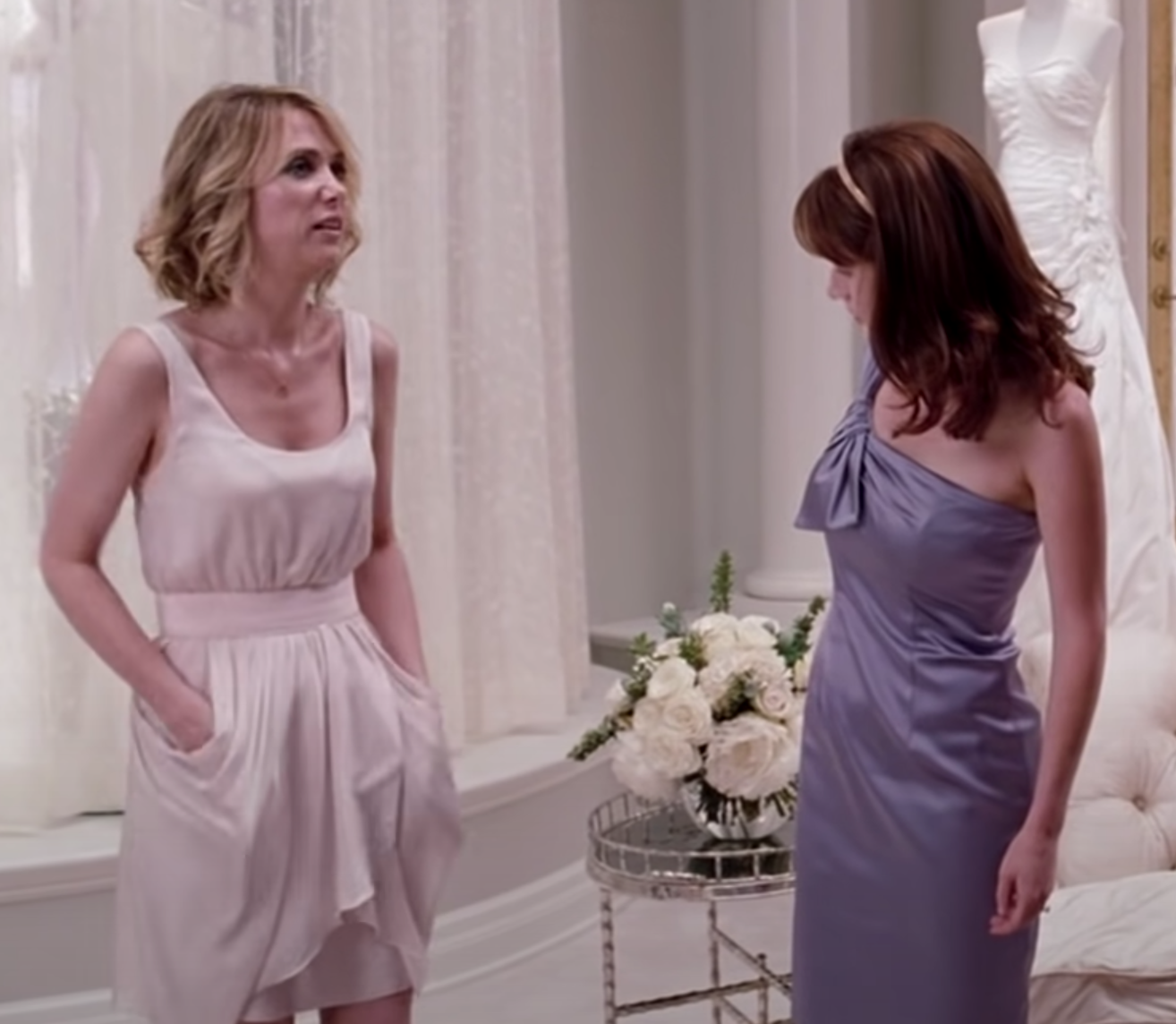 "Annie from ""Bridesmaids"" wearing a dress with pockets"
