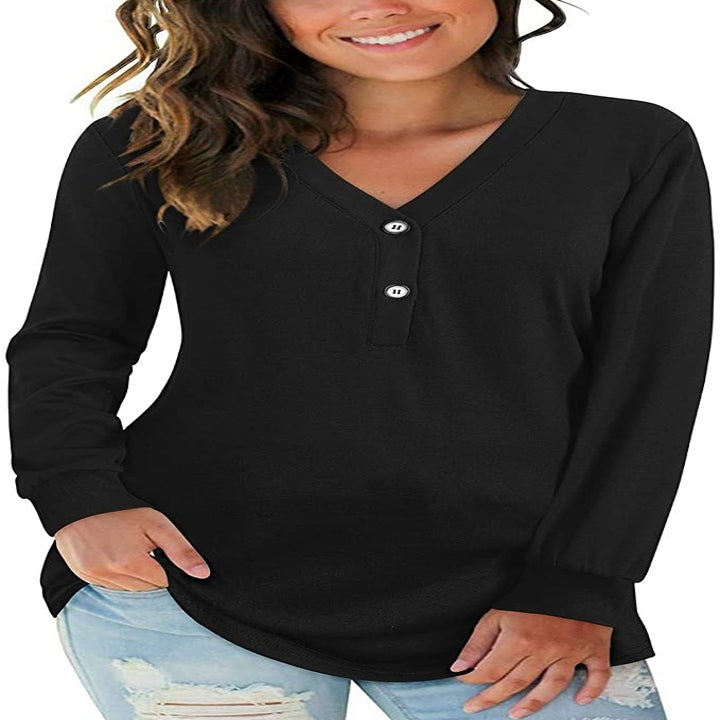 a model in a long sleeve black top