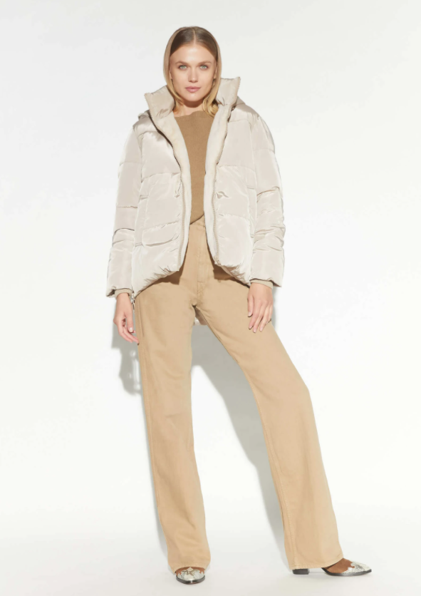 model wearing a taupe puffer coat