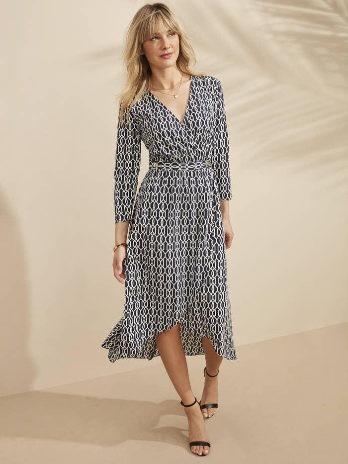 Model in long sleeve printed midi wrap dress