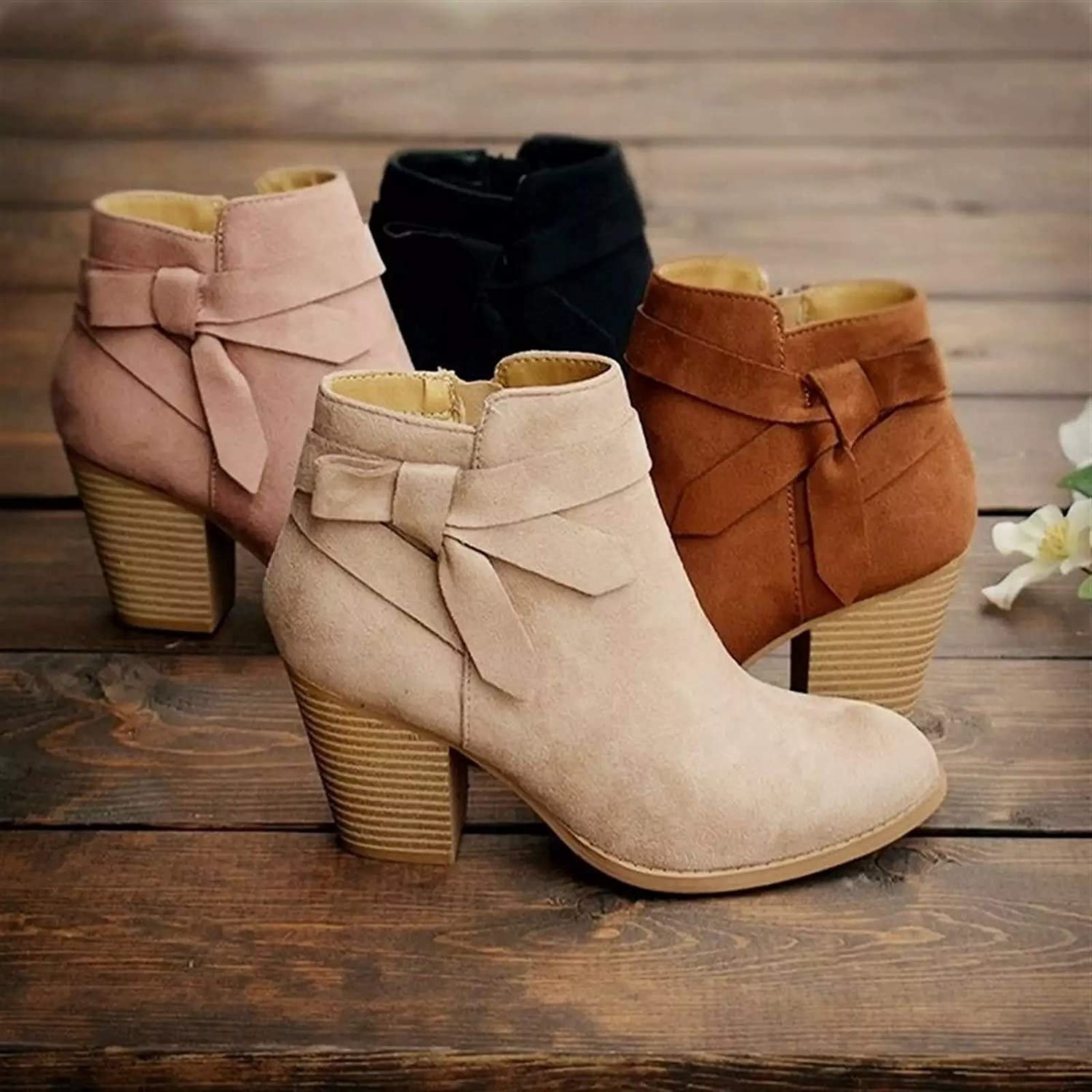 The booties with decorative knots at the ankle in tan, pink, brown, and black