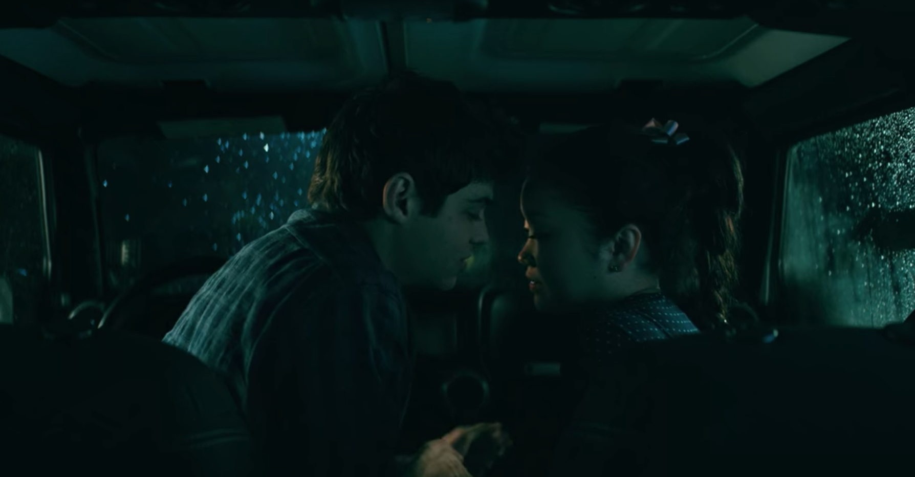 "Lara Jean and Peter kissing in the car in ""To All The Boys: P.S. I Still Love You"""
