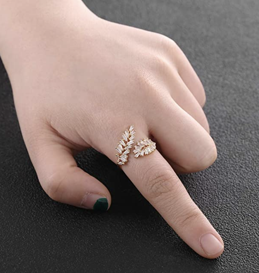 person wears leaf ring