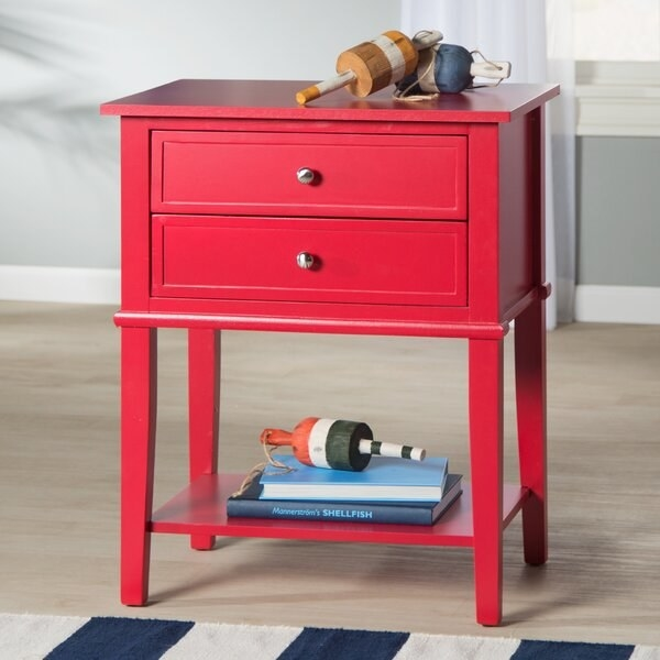The table in red, which has two drawers and an open storage shelf