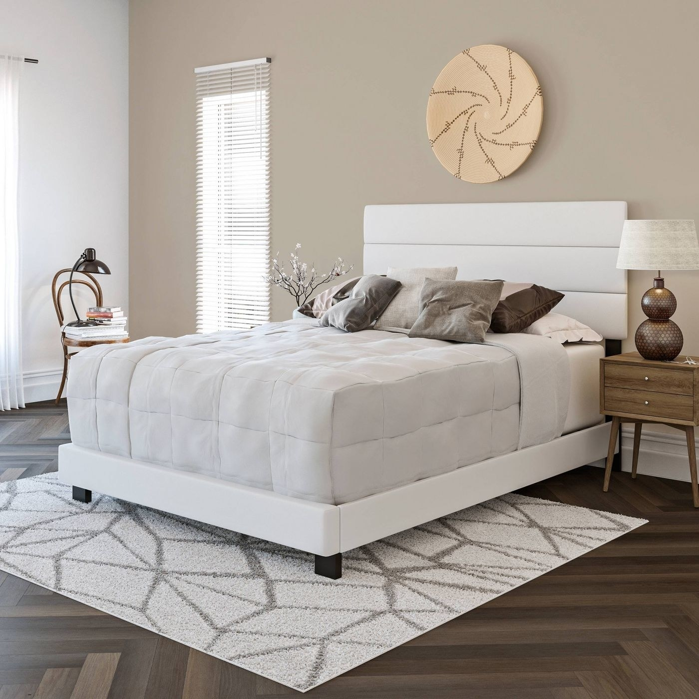 A white faux leather platform bed