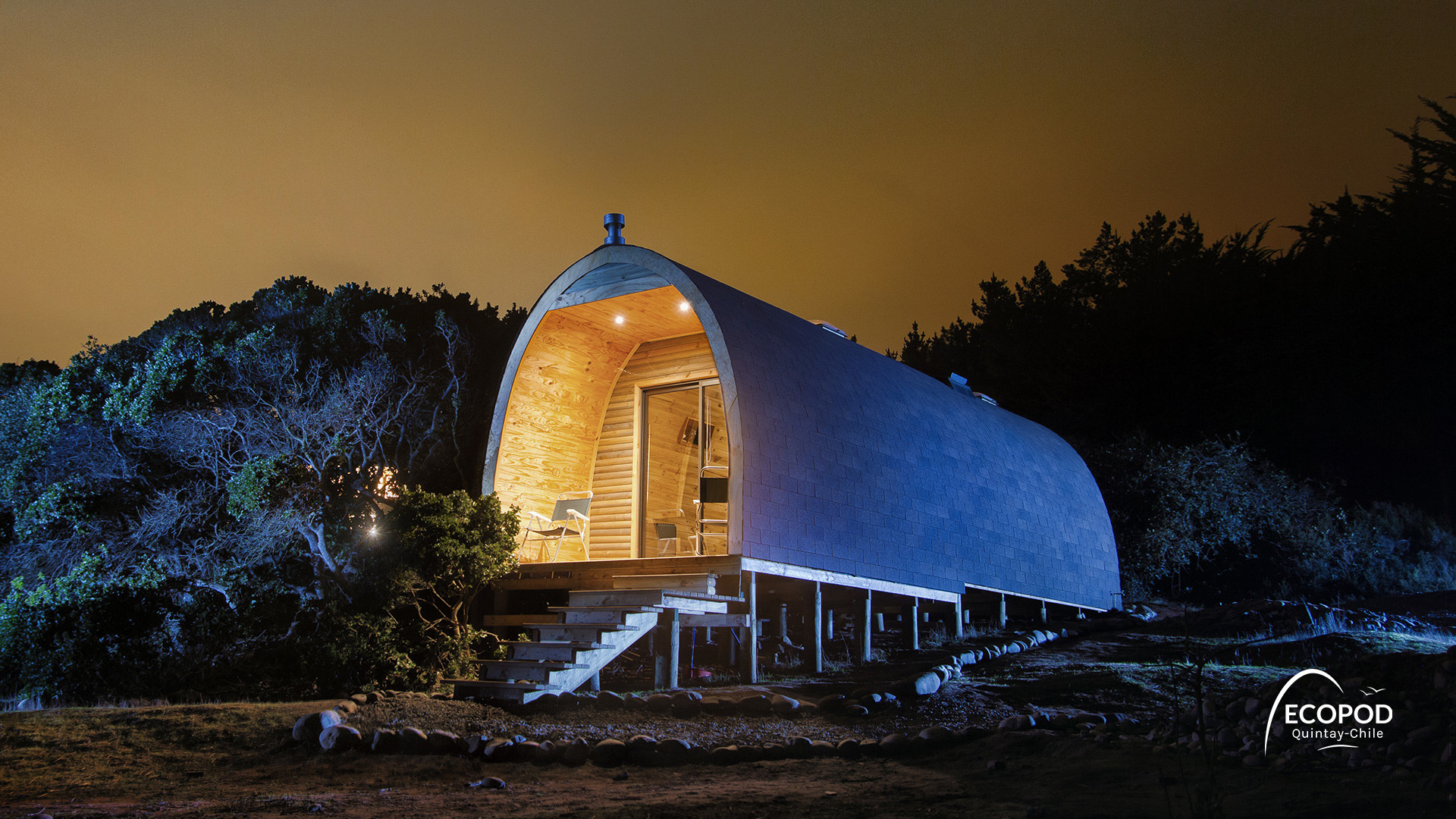 A domed wooden hut with a big glass foor