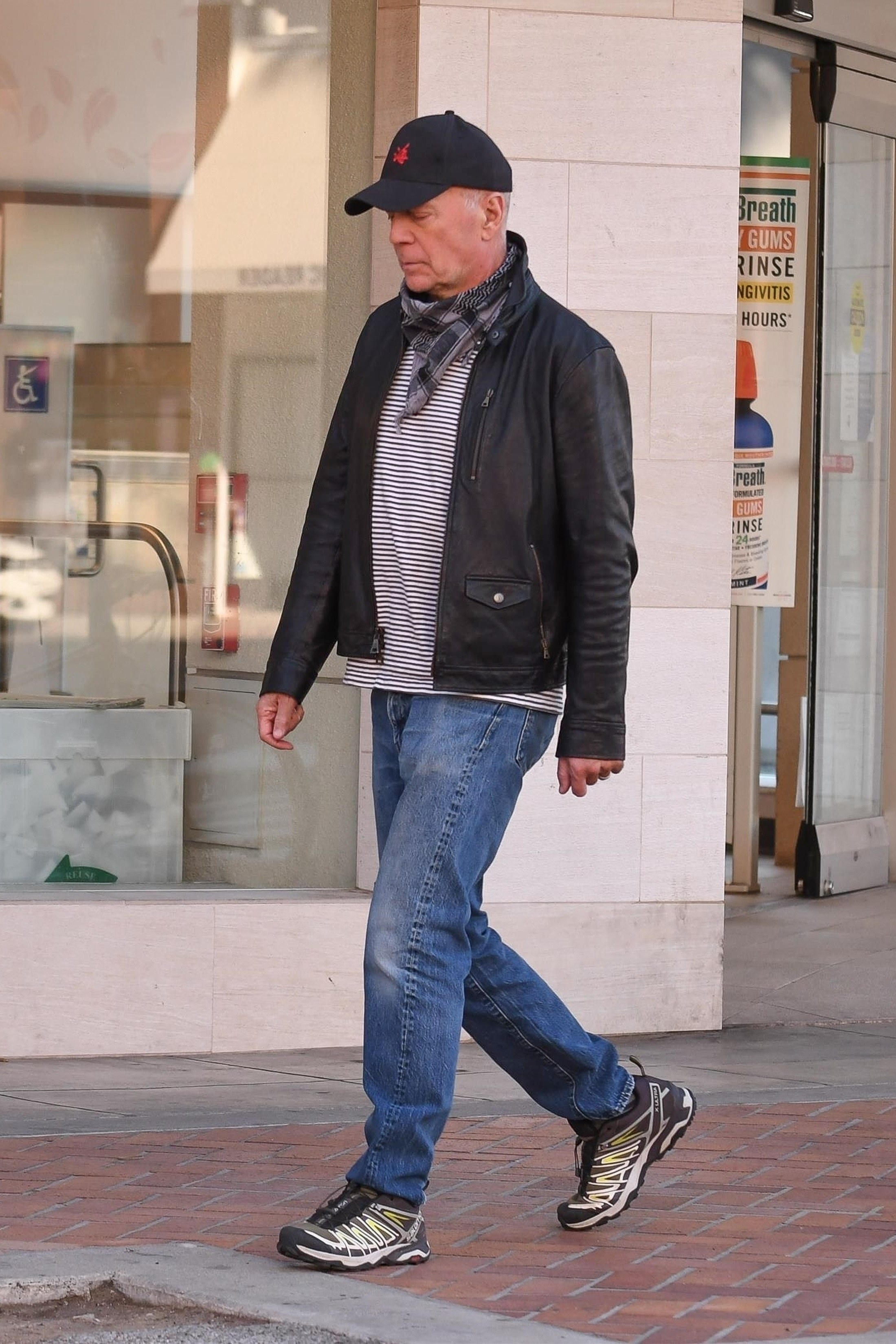 Bruce Willis is spotted walking away from a store without wearing a mask