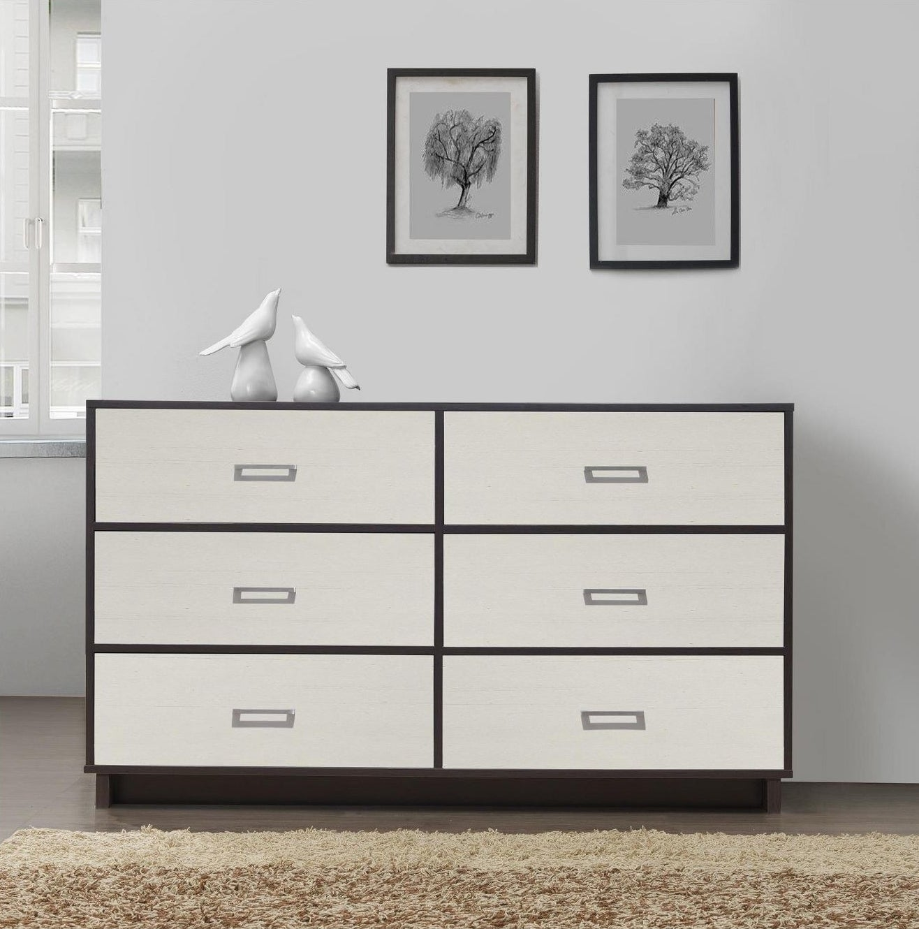 A six drawer dresser with a two tone finish in brown espresso and white and silver handles