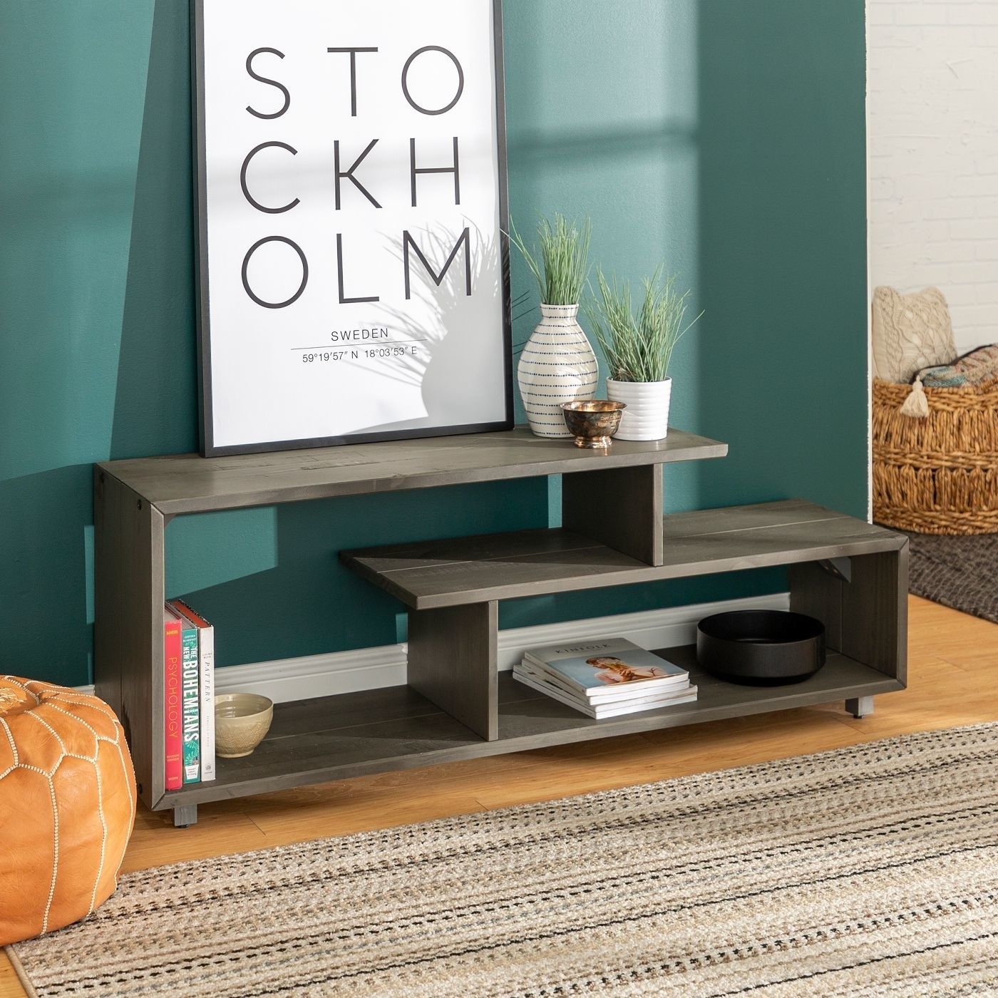 A rustic wood TV stand in a gray wash