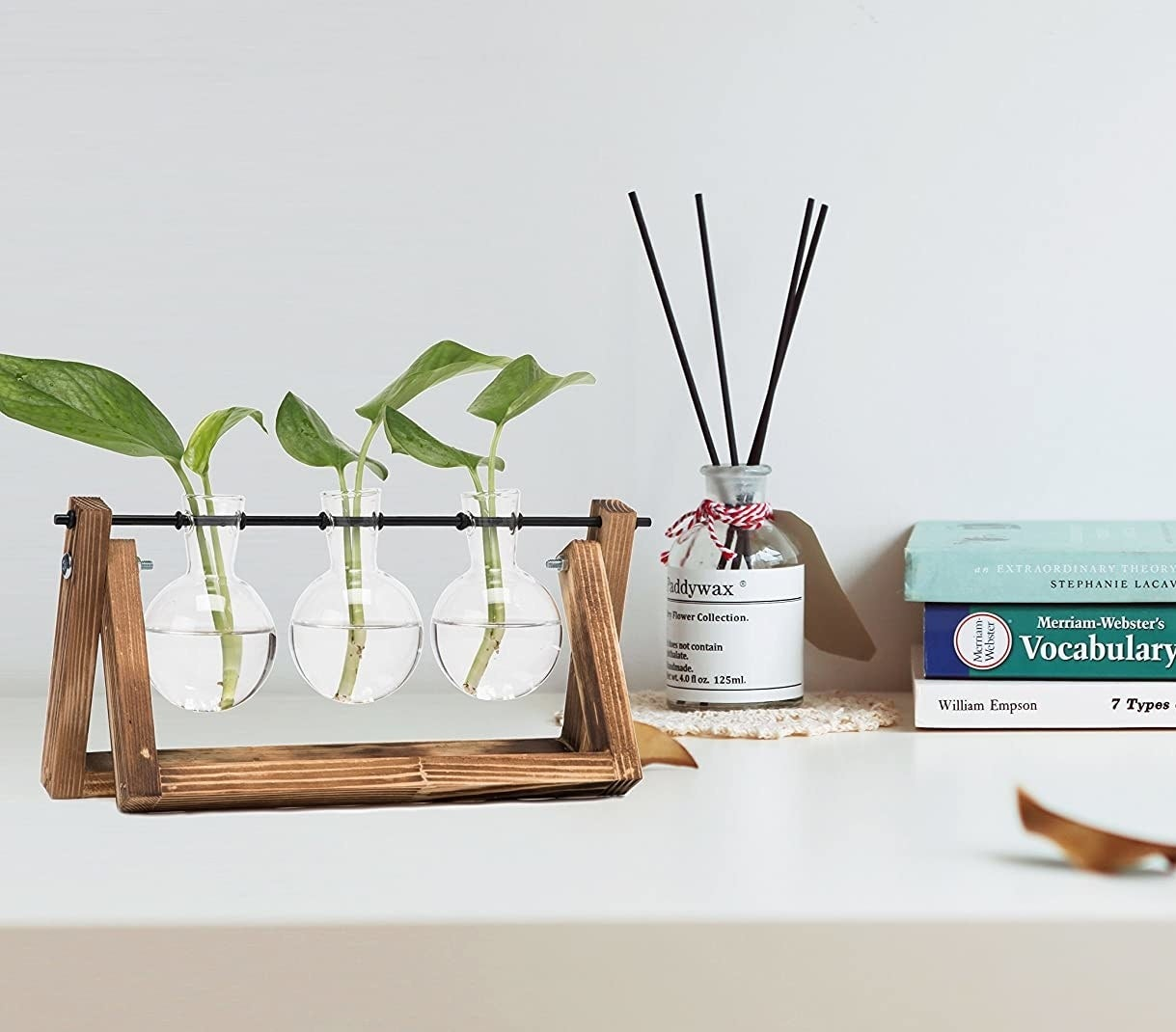 The water bulb planters on a desk beside incense and books