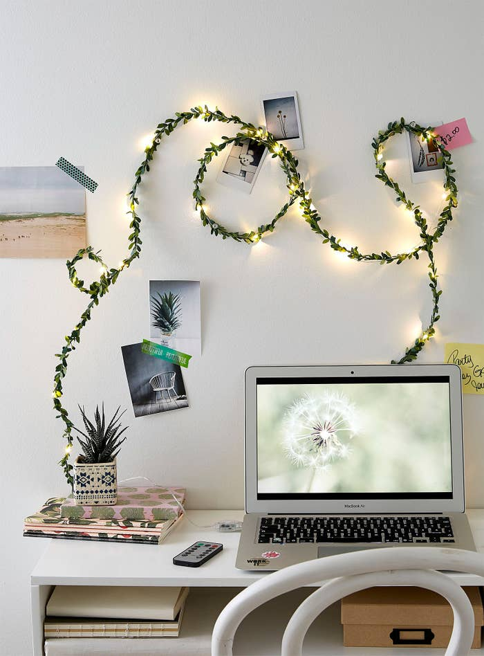 a string of foliage light in a room over a desk