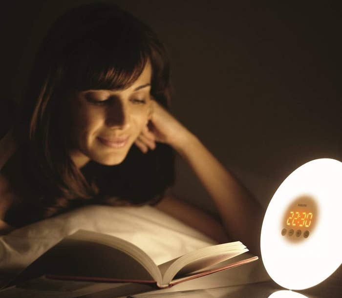person reading with the light on
