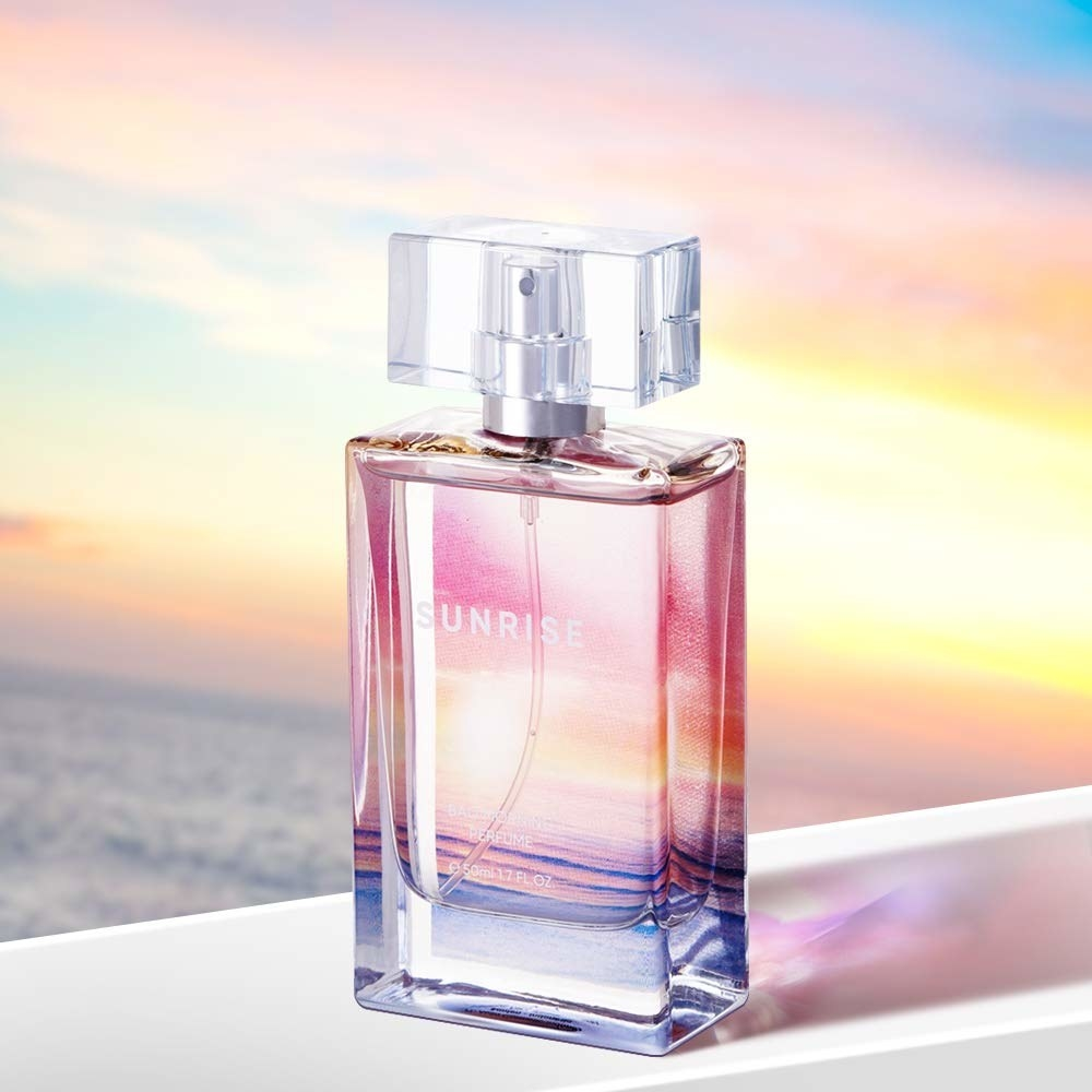 A perfume against a pastel background
