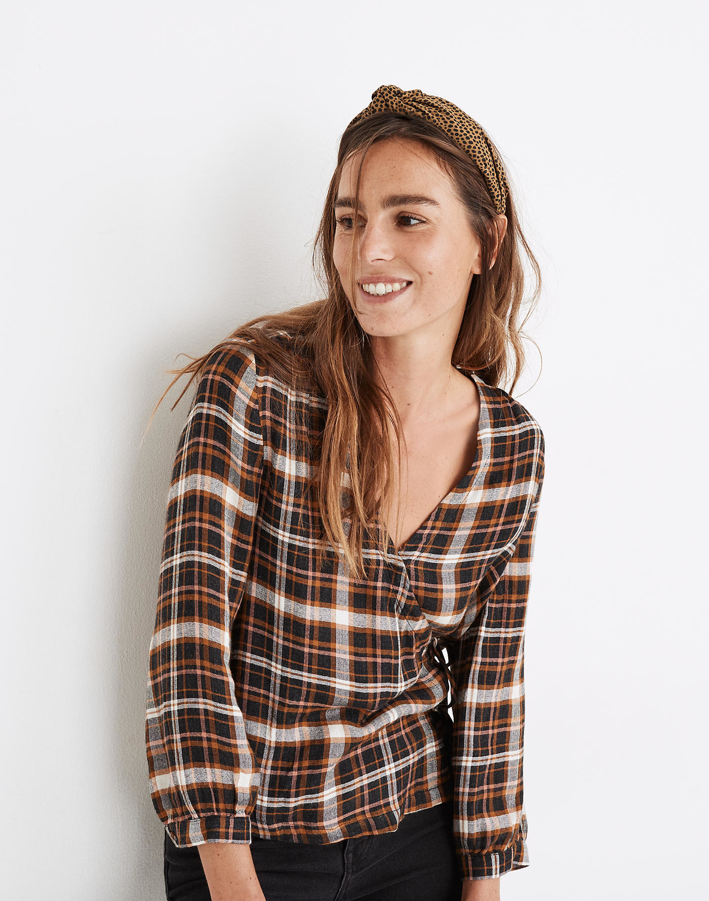 Model wearing plaid shirt