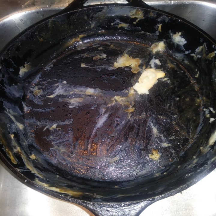 a reviewer showing a mess of food caked onto the bottom of their pan