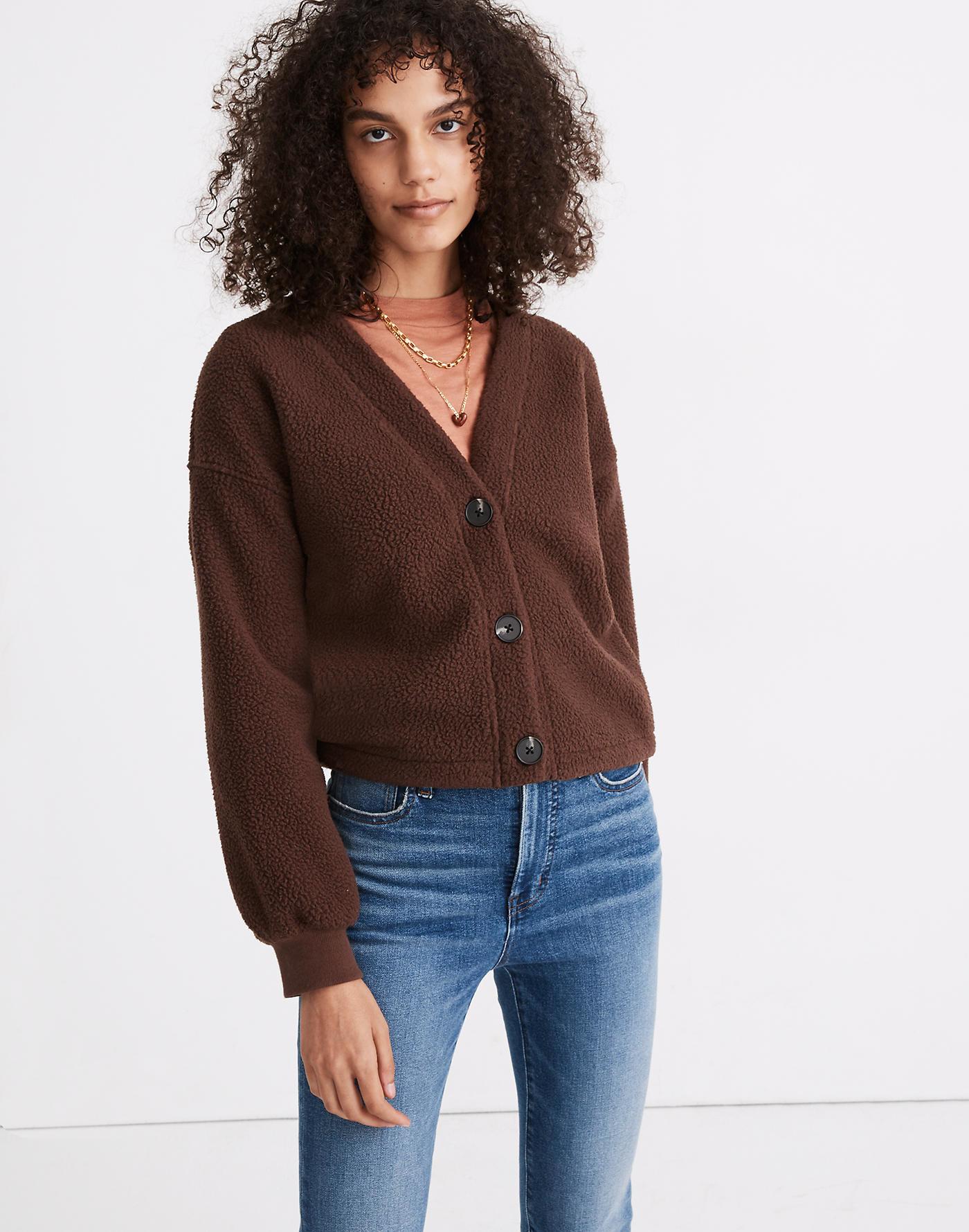 Model wearing fuzzy brown cardigan