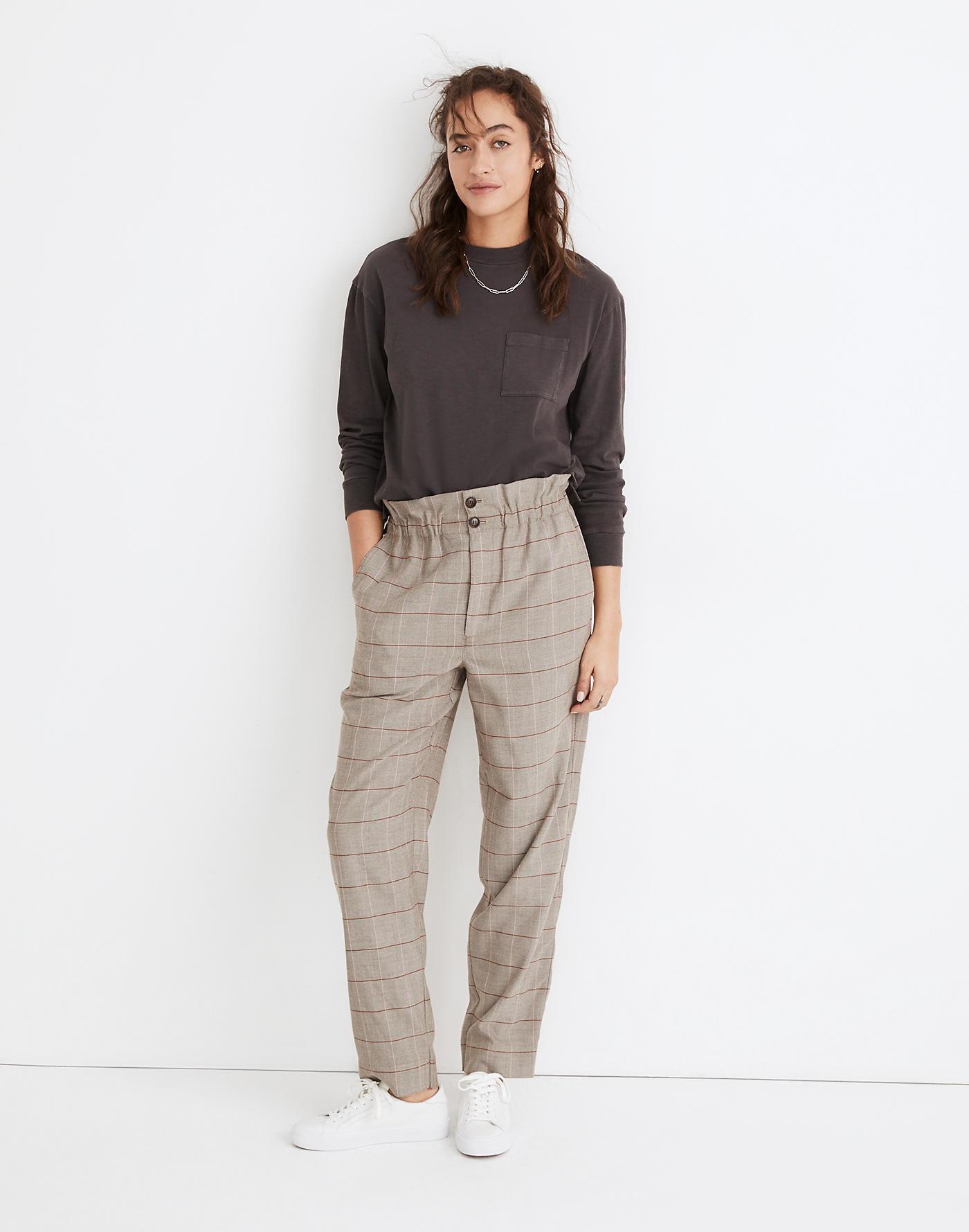 Model wearing paperbag plaid pants