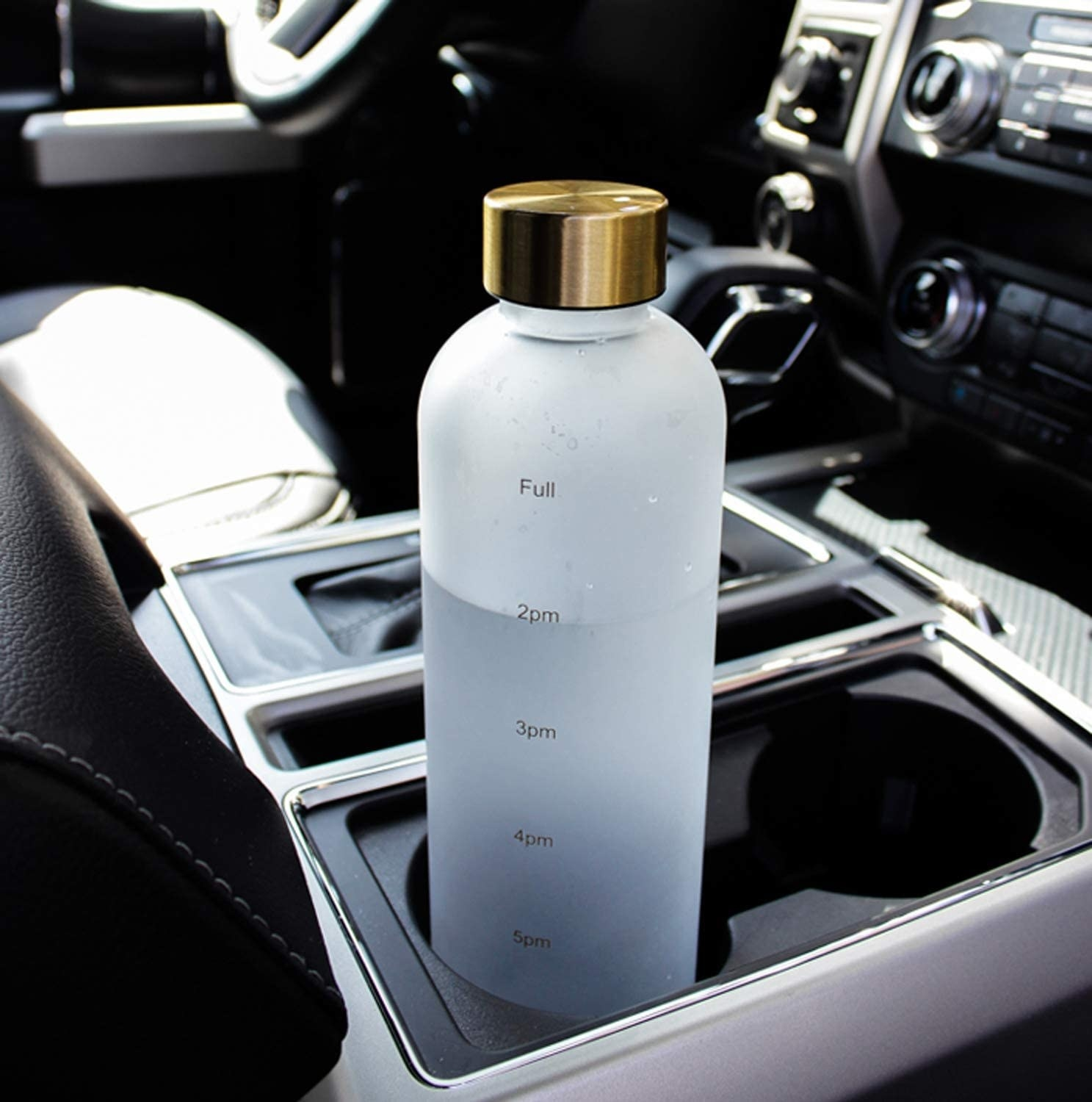 The water bottle in a car's cup holder