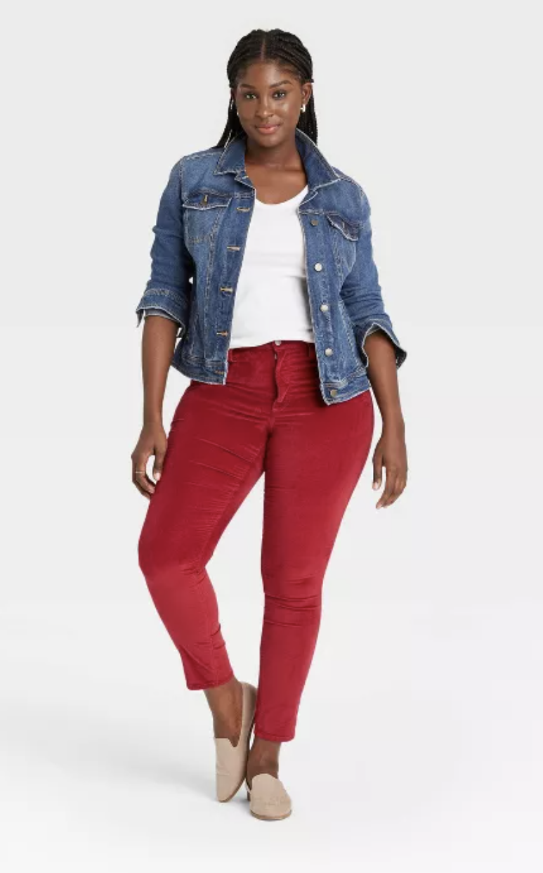 Model wears red velvet skinny jeans with a white tee and denim jacket